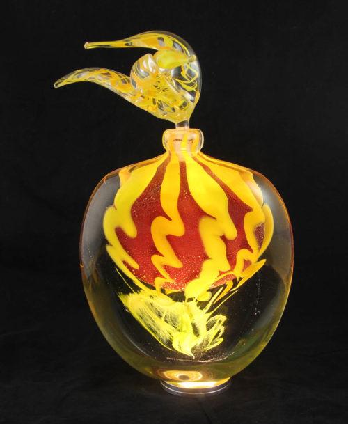 Flacon jaune, rouge et feuilles d'or